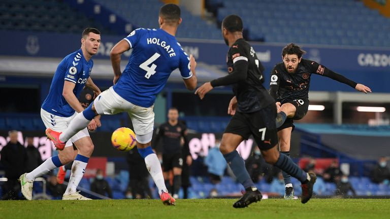 Manchester City's Bernardo Silva, right, scores his side's third goal during the English Premier League soccer match between Everton and Manchester City at Goodison Park stadium, in Liverpool, England, Wednesday, Feb. 17, 2021. (Michael Regan/Pool via AP)