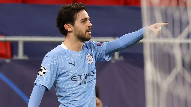 Bernardo Silva gestures to his team-mates after scoring Man City's opening against Borussia Monchengladbach