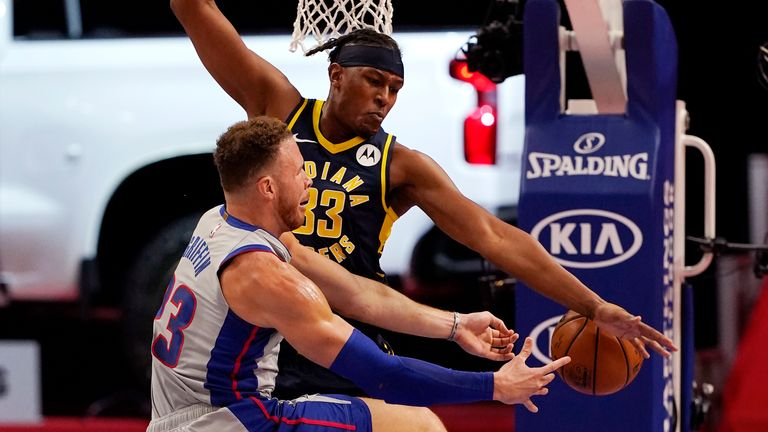 Detroit Pistons forward Blake Griffin loses control of the ball as Indiana Pacers center Myles Turner defends