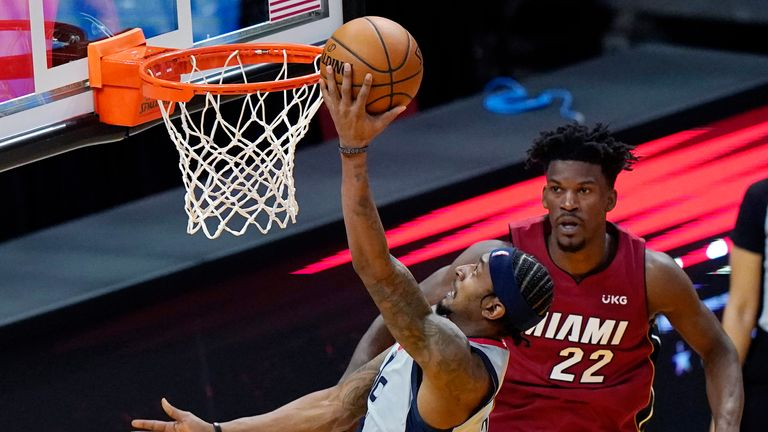 Washington Wizards guard Bradley Beal shoots over Miami Heat forward Jimmy Butler
