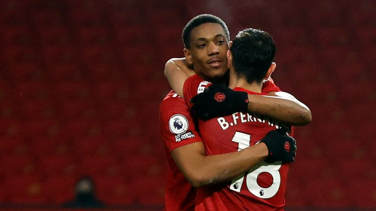Bruno Fernandes celebrates with Anthony Marital after scoring Man Utd's seventh goal from the penalty spot (AP)