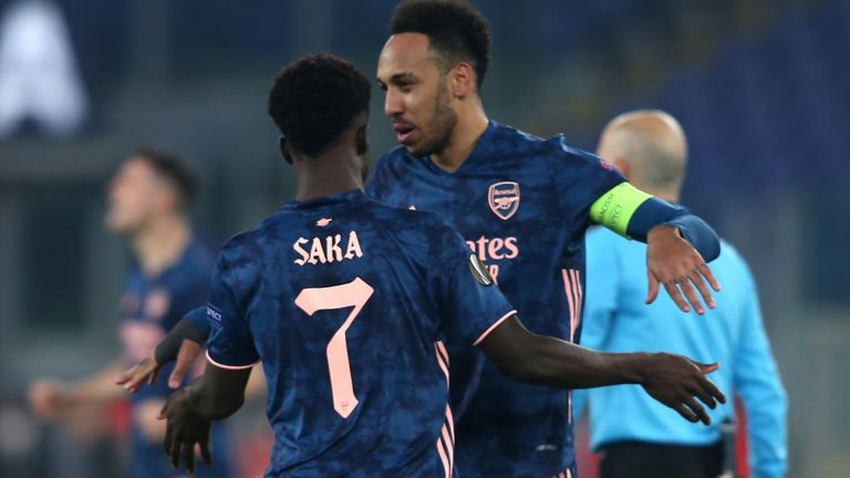 Bukayo Saka celebrates with Pierre-Emerick Aubameyang after equalising against Benfica