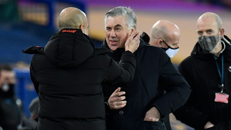 Carlo Ancelotti is greeted by Pep Guardiola prior to kick-off at Goodison