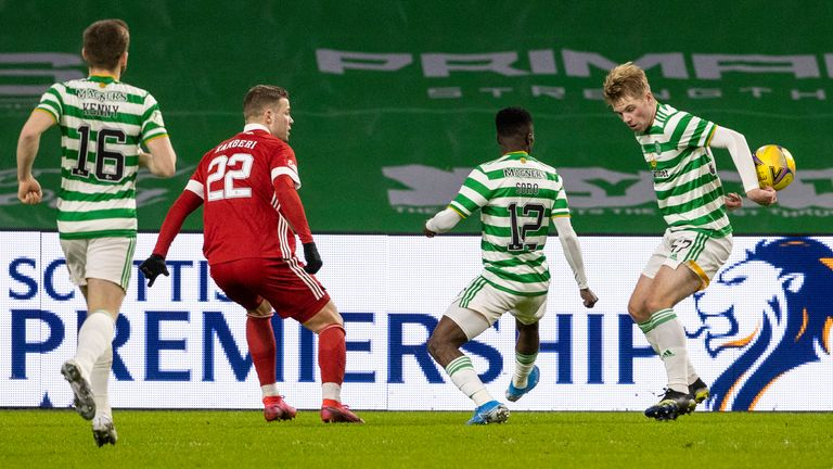 Florian Kameri claims for a Stephen Welsh handball during a Scottish Premiership match between Celtic and Aberdeen at Celtic Park