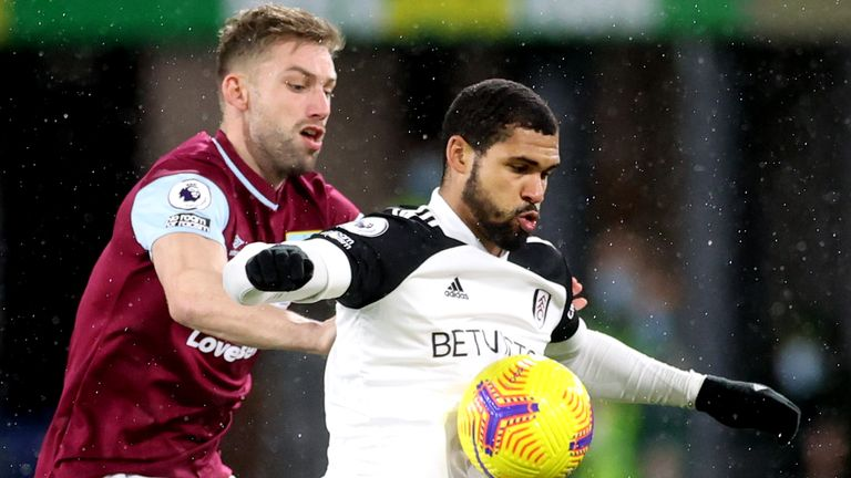 Burnley's Charlie Taylor and Fulham's Ruben Loftus-Cheek battle for the ball