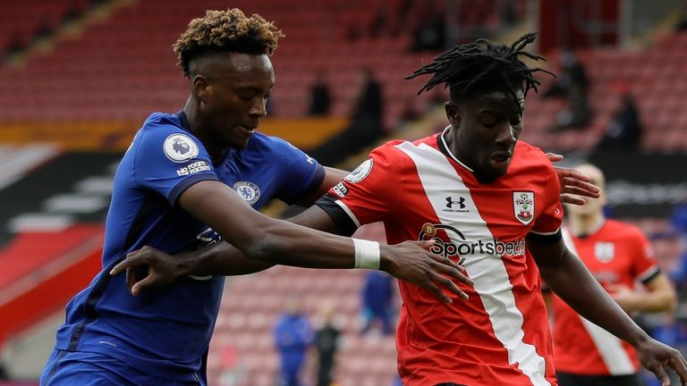 Chelsea's Tammy Abraham (left) and Southampton's Mohammed Salisu challenge for the ball