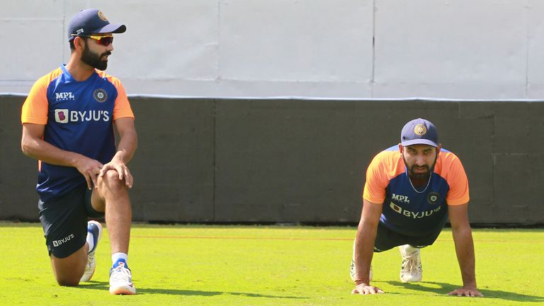 Pujara (right) hopes his experiences playing in England will help him should the pink ball swing in Ahmedabad