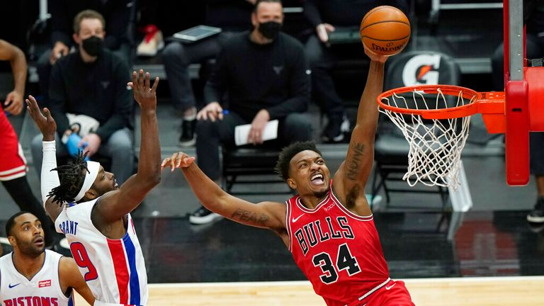 AP - Chicago Bulls center Wendell Carter Jr., right, drives to the basket past Detroit Pistons guard Wayne Ellington