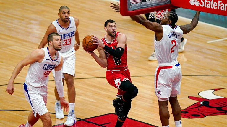 AP - Chicago Bulls guard Zach LaVine (8) drives to the basket against Los Angeles Clippers center Ivica Zubac, left, forward Nicolas Batum