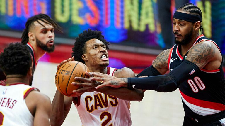 AP - Cleveland Cavaliers guard Collin Sexton, left, fouled by Portland Trail Blazers striker Carmel Anthony