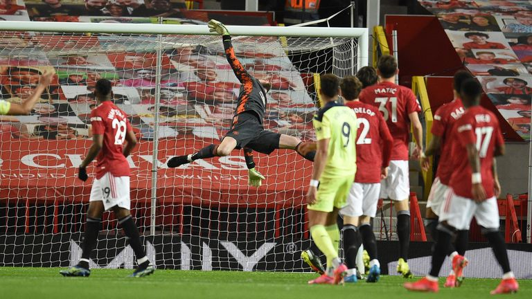 David de Gea dives at full stretch to deny Joelinton in the opening period