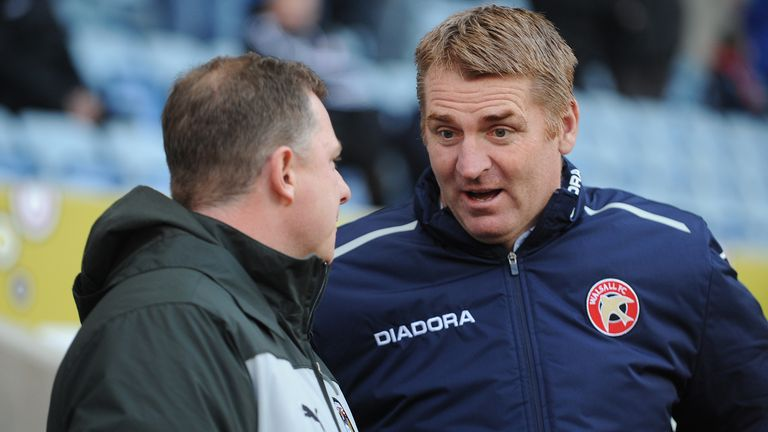 Coventry City manager Mark Robins (left) talks to Walsall manager Dean Smith