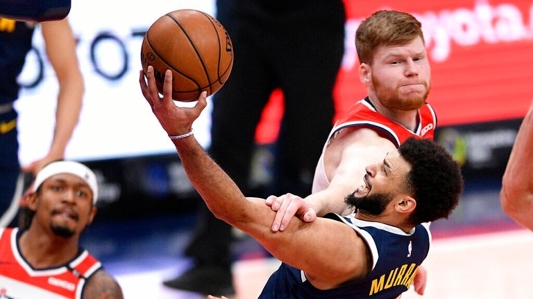AP - Denver Nuggets guard Jamal Murray (27) is fouled by Washington Wizards forward Davis Bertans