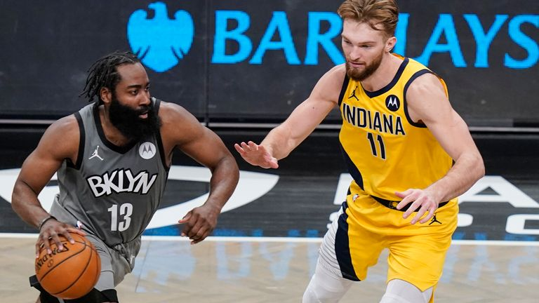 Brooklyn Nets' James Harden drives past Indiana Pacers' Domantas Sabonis