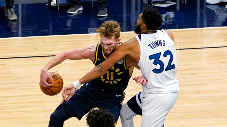 AP - Indiana Pacers' Domantas Sabonis (11) tries to drive around Minnesota Timberwolves' Karl-Anthony Towns