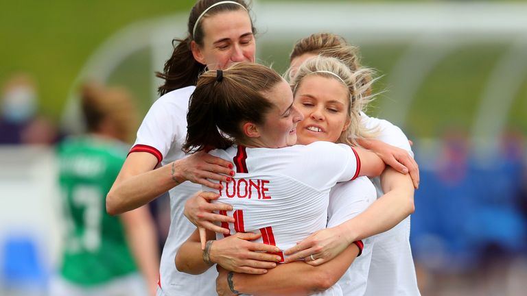 Ella Toone is congratulated for her penalty on England debut