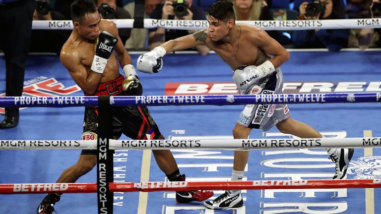 Jeo Santasima (left) and Emanuel Navarette during the World Boxing Organisation World Super Bantam Title bout at the MGM Grand, Las Vegas. PA Photo. Picture date: Saturday February 22, 2020. See PA story BOXING Las Vegas. Photo credit should read: Bradley Collyer/PA Wire.