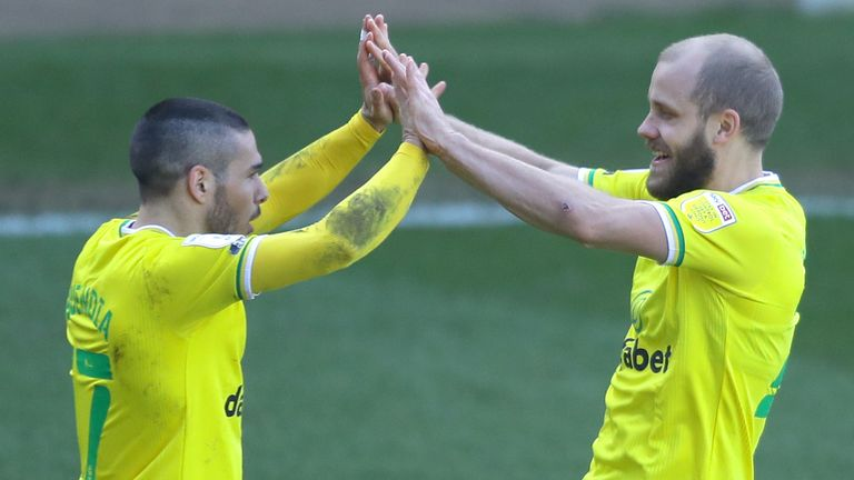 Teemu Pukki celebrates his goal with Emiliano Buendia