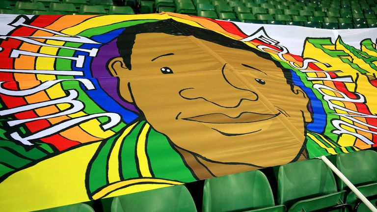 NORWICH, ENGLAND - DECEMBER 09: A banner of former footballer Justin Fashanu is seen inside the stadium ahead of the Sky Bet Championship match between Norwich City and Nottingham Forest at Carrow Road on December 09, 2020 in Norwich, England. A limited number of spectators (2000) are welcomed back to stadiums to watch elite football across England. This was following easing of restrictions on spectators in tiers one and two areas only. (Photo by Stephen Pond/Getty Images)