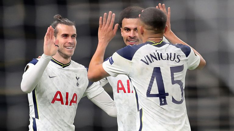 Gareth Bale celebrates with fellow goalscorers Dele Alli and Carlos Vinicius