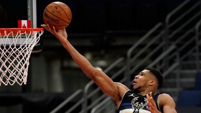 Milwaukee Bucks forward Giannis Antetokounmpo puts in a layup