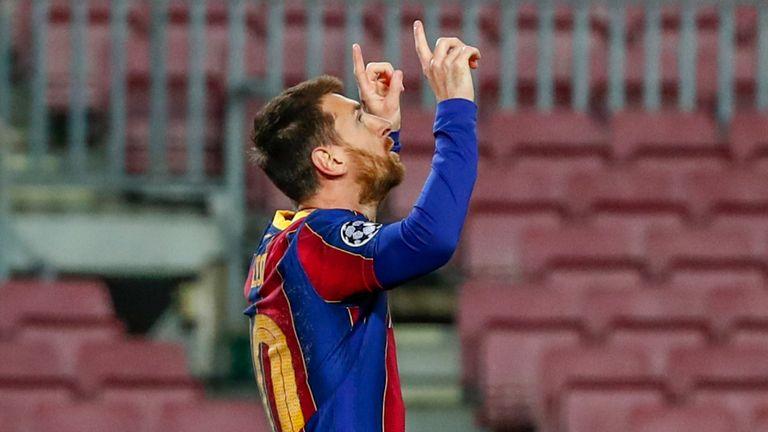 Lionel Messi celebrates after scoring for Barcelona against PSG