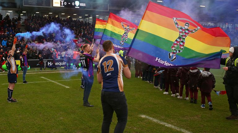 Rainbow smoke grenades and flags greeted the teams when Harlequins ran out for professional rugby's first-ever Pride Game in February 2020