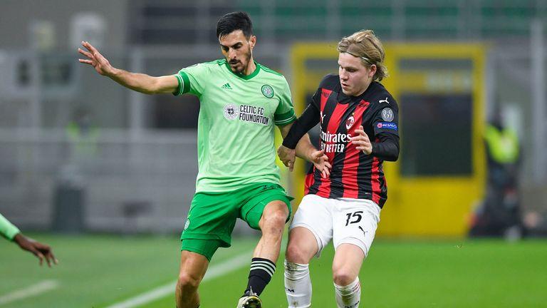 Celtic's Hatem Abd Elhamed (L) holds off AC Milan's Jens Petter Hauge during a UEFA Europa League match