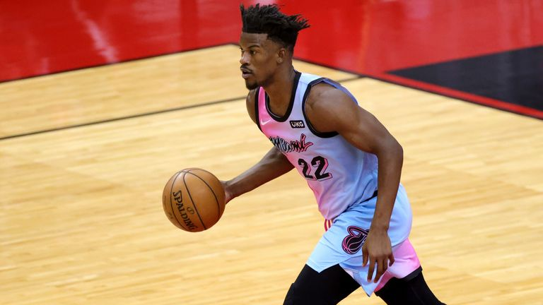 Miami Heat's Jimmy Butler brings the ball up during the first quarter against the Houston Rockets