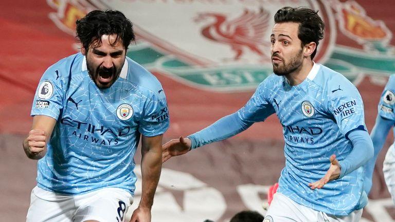 Ilkay Gundogan celebrates scoring for Man City against Liverpool