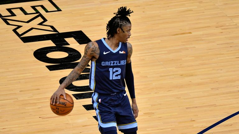 Memphis Grizzlies guard Ja Morant handles the ball against the Charlotte Hornets
