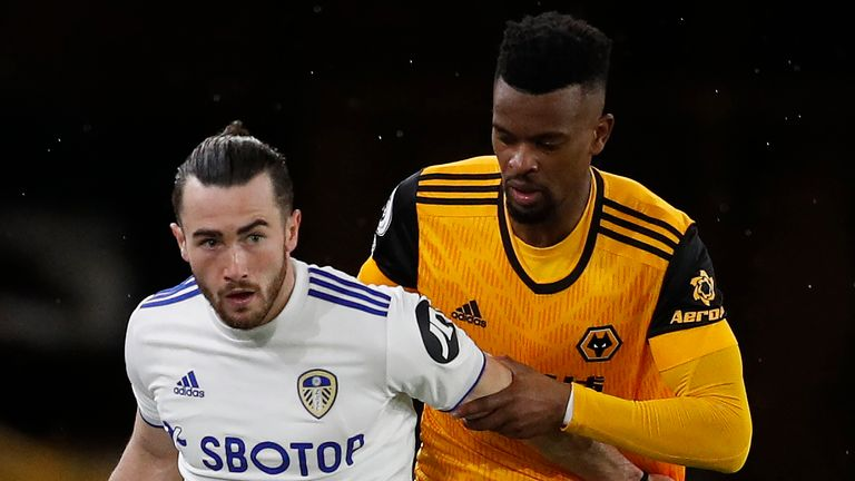 Leeds United's Jack Harrison is held up by Wolves defender Nelson Semedo