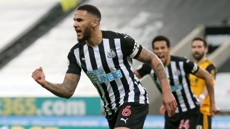 Jamaal Lascelles is celebrating after leading Newcastle ahead of the Wolves