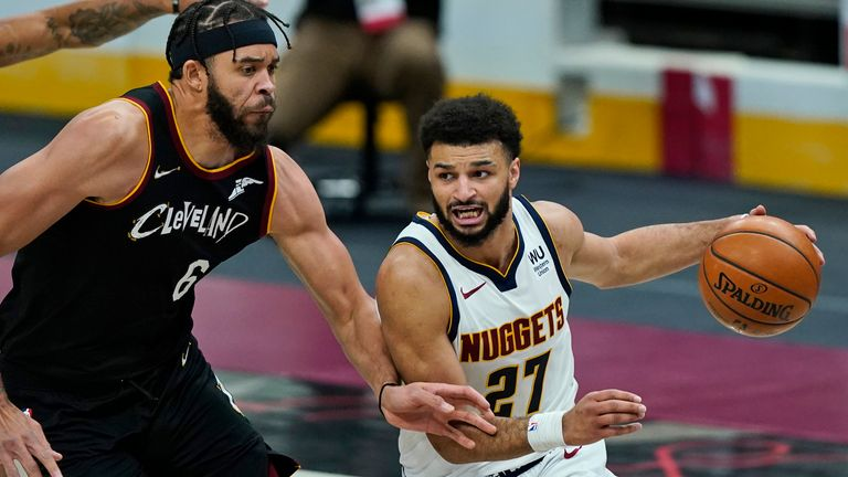 Denver Nuggets' Jamal Murray drives past Cleveland Cavaliers' JaVale McGee