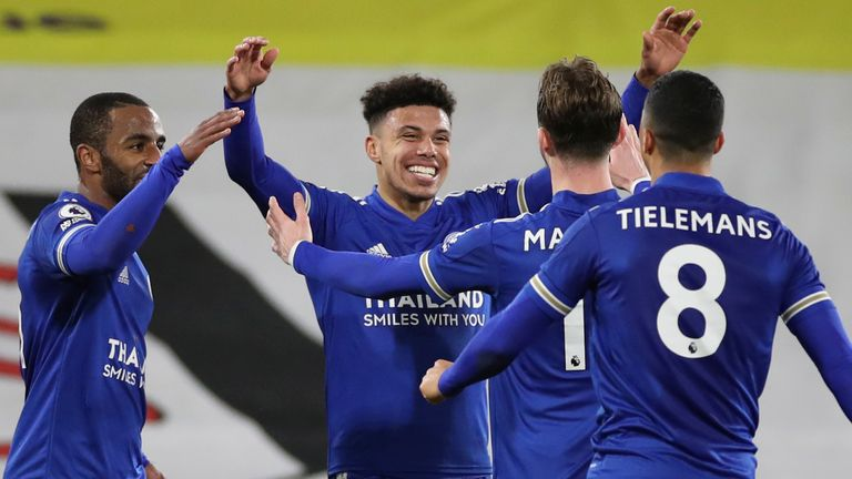 James Justin celebrates with team-mates after doubling Leicester's lead (AP)