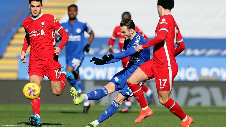 James Maddison shoots from his own half under pressure from Liverpool's Ozan Kabak and Curtis Jones