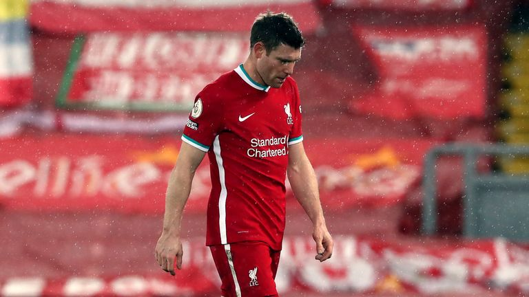 James Milner shows his dejection as he leaves the pitch