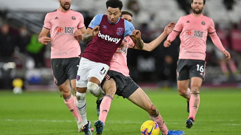 Chris Basham brings down Jesse Lingard to give West Ham a penalty