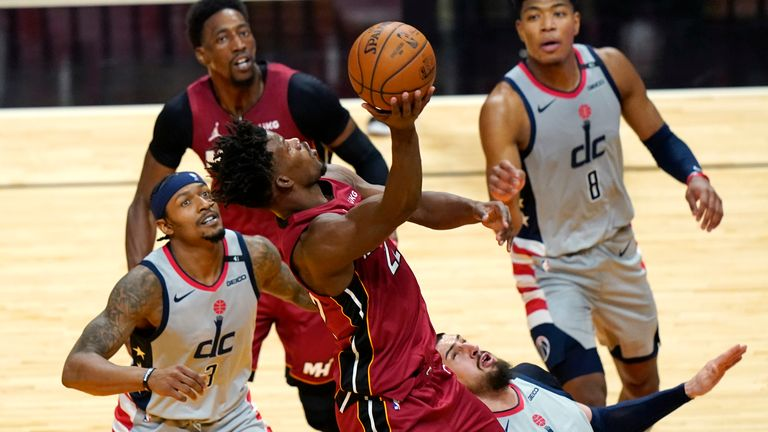 Miami Heat forward Jimmy Butler goes to the basket as Washington Wizards' Bradley Beal and Alex Len defend