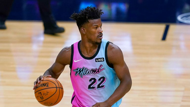 AP - Miami Heat forward Jimmy Butler brings the ball up against the Golden State Warriors