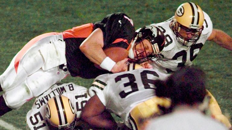 John Elway dives for the first-down marker in his famous 'helicopter' run in Denver's Super Bowl XXXII win over Green Bay