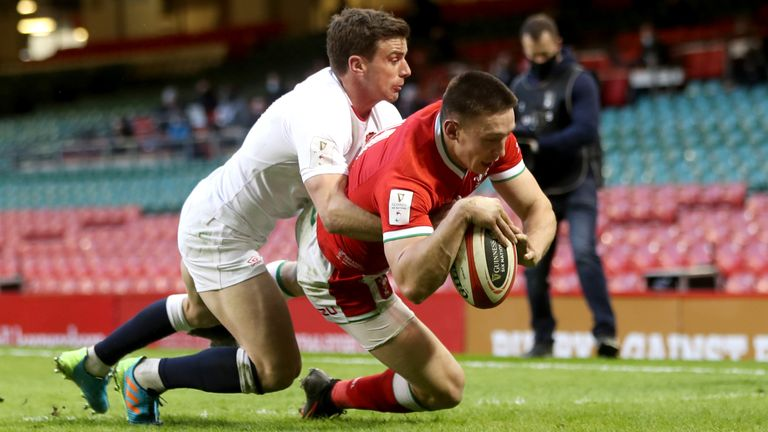 Wales' Josh Adams dives to score his side's first try against England