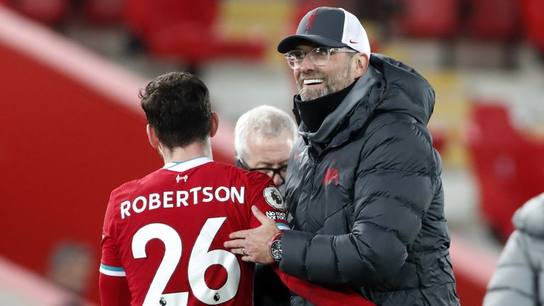 Jugen Klopp embraces Andrew Robertson at Anfield