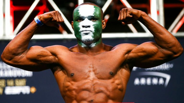 AP - Kamaru Usman poses during the ceremonial weigh-in event ahead of his fight against Colby Covington