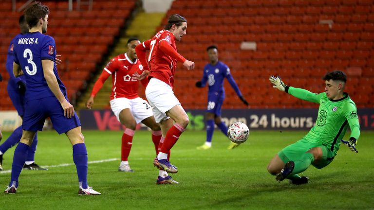 Barnsley's Callum Brittain sees his shot saved by Chelsea goalkeeper Kepa Arrizabalaga