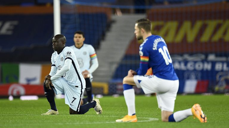 Chelsea's N'Golo Kante and Everton's Gylfi Sigurdsson (right) take the knee in support of the black lives matter movement during the Premier League match at Goodison Park, Liverpool.