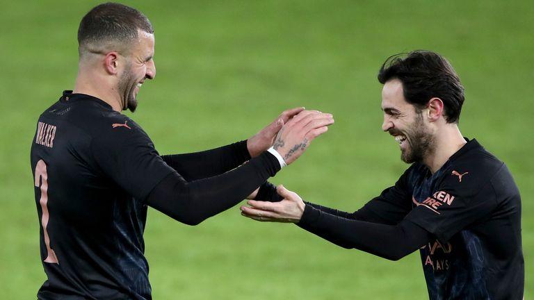 Kyle Walker celebrates scoring Manchester City's opening goal against Swansea with Bernardo Silva