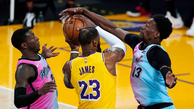 Los Angeles Lakers forward LeBron James has his shot blocked by Miami Heat center Bam Adebayo
