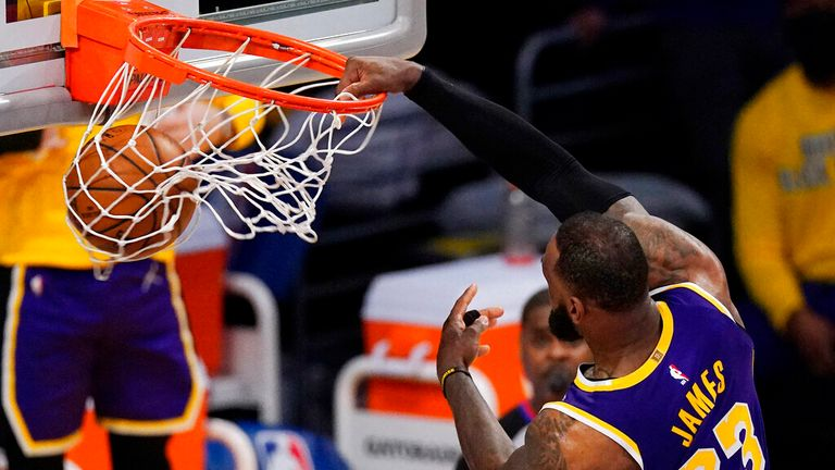 AP - Los Angeles Lakers forward LeBron James dunks during the second half of the team's NBA basketball game against the Memphis Grizzlies