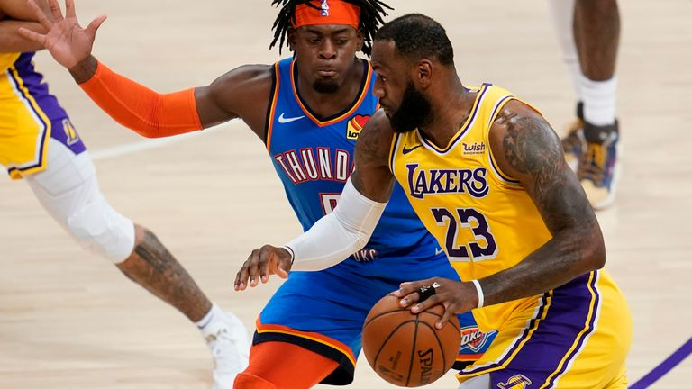 Oklahoma City Thunder forward Luguentz Dort defends against Los Angeles Lakers forward LeBron James